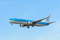 Airplane KLM Royal Dutch Airlines PH-BXT Boeing 737-900 is landing at Schiphol airport. Stock Photos
