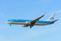 Airplane KLM Royal Dutch Airlines PH-BXT Boeing 737-900 is landing at Schiphol airport. Royalty Free Stock Images