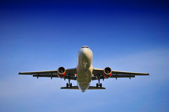 Airplane Landing. An airplane landing in a blue sky stock photography