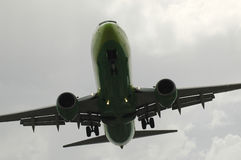 Airplane at landing. Seen from the bottom Stock Images