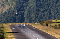Airplane landing. Small airplane landing on the airstrip of Lukla in the Nepalese Himalaya's?  Starting point of the trekking to Everest Stock Photo