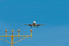 Airplane landing Stock Photo