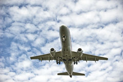 Airplane landing. Passenger airplane with the sky and clouds in the background Royalty Free Stock Photography
