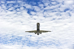 Airplane landing. Passenger airplane with the sky and clouds in the background Royalty Free Stock Image