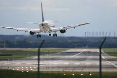 Airplane Landing. A picture of a landing airplane at the airport Stock Photos