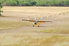 Airplane Landing. Monomotor Airplane landing on grass runway Royalty Free Stock Photos