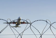 Airplane landing. At Malpensa airport - Milan - the focus is on barbed Stock Photo