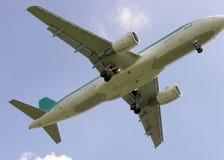 Airplane landing. Underside view of landing airplane Stock Image