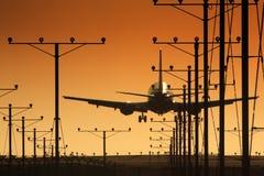 Airplane landing. Plane landing in airport at sunset Stock Image