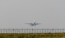 Airplane Landing on The Airport Stock Photography