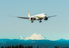 Airplane landing at airport Stock Photography