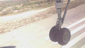 Airplane landing on airport runway stock footage