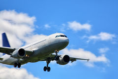 Airplane landing Royalty Free Stock Image
