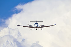 Airplane Landing Approach. Airplane in landing configuration against a backdrop of cumulous clouds Stock Photo