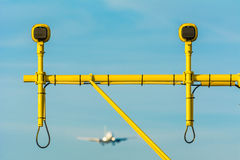 Airplane is landing behind the runway lights. Royalty Free Stock Photography