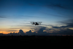 Airplane landing with blue sky Royalty Free Stock Images