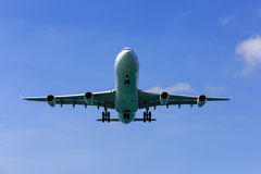 Airplane landing Stock Images