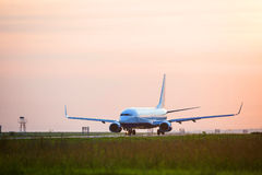 Airplane is landing. Cargo plane in landing in the airport Stock Photography
