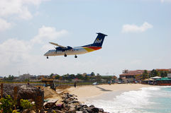 Airplane Landing on Caribbean Island Royalty Free Stock Photos