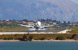 Airplane landing on Corfu airport Stock Images
