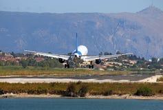 Airplane landing on Corfu airport Stock Photo