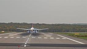 Airplane landing at Dusseldorf Airport stock footage
