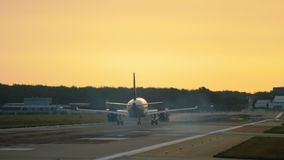 Airplane landing at the early morning stock footage