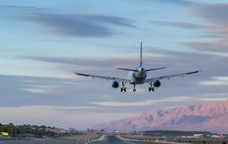 Airplane is landing at Eilat, Israel Royalty Free Stock Image