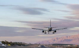 Airplane is landing at Eilat, Israel Stock Photos
