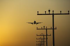 Airplane landing at frankfurt airport at sunrise Stock Photo