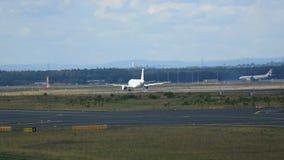Airplane landing at Frankfurt. FRANKFURT AM MAIN, GERMANY - SEPTEMBER 4, 2015: Tunisair Airbus 320 TS-IML landing at runway 25L. Unofficial spotting in Fraport stock video footage