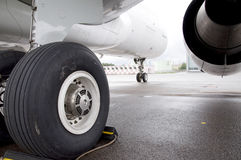 Airplane landing gear. Airplane jet engine and chassi view from back Royalty Free Stock Images