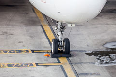 Airplane landing gear wheel parking on ground Royalty Free Stock Images