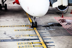 Airplane landing gear wheel parking on ground Stock Images