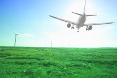 Airplane landing with green grassland Stock Image