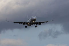 Airplane Landing. A jet airplane coming in for a landing with wheels down Stock Photos