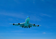 An airplane landing. A 747 jumbojet landing in an airport Royalty Free Stock Image