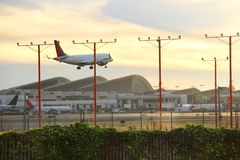 Airplane landing in LA Airport Stock Images