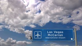 Airplane landing at Las Vegas McCarran Nevada. Jet plane landing in Las Vegas McCarran, Nevada, USA. City arrival with airport direction sign. Travel, business stock video footage