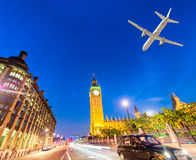 Airplane landing in London, UK. Tourism concept Royalty Free Stock Images