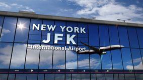 Airplane landing at New York, JFK, Kennedy mirrored in terminal