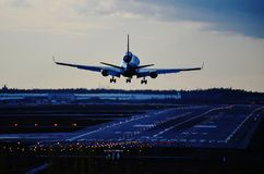 Airplane landing nightime Royalty Free Stock Images