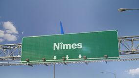 Airplane Landing Nimes. Airplane flying over airport signboard stock video footage