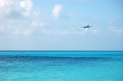 Airplane Landing over Sea Royalty Free Stock Image