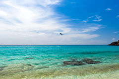 Airplane landing over the sea Stock Photos