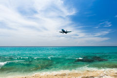 Airplane landing over the sea Stock Image
