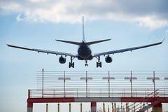 Airplane landing Stock Photo