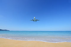 The airplane landing at Phuket airport over the Mai Khao Beach stock photography