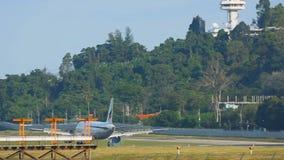 Airplane landing in Phuket airport stock footage