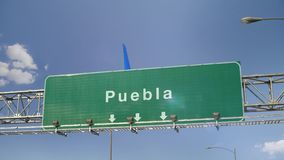 Airplane Landing Puebla. Airplane flying over airport signboard stock video footage